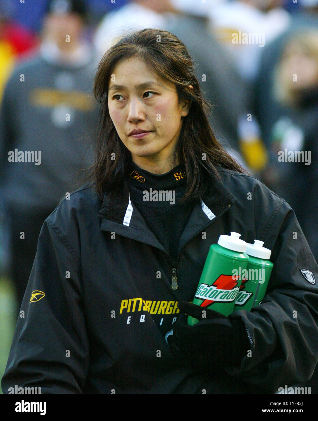 innovative design 986a7 154dc Pittsburgh Steelers assistant trainer Ariko Iso walks the ...