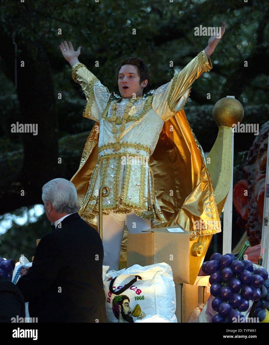 "Actor Elijah Wood, star of the ""Lord of the Rings"" movies reigns as Bacchus 2004 during the Krewe of Bacchus Parade in Uptown New Orleans February 22, 2004. Fat Tuesday is February 24.   (UPI Photo / A.J. Sisco) Stock Photo"