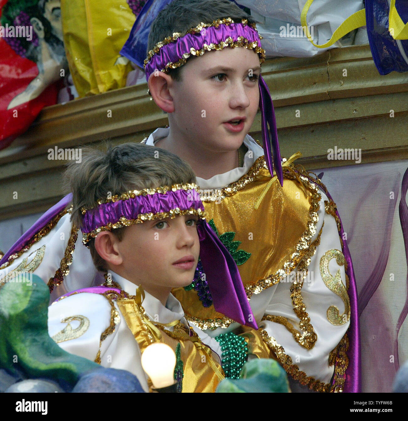 """Members of the krewe of Bacchus parade in Uptown New Orleans February 22, 2004. The Krewe of Bacchus always has a guest celebrity reigning as Bacchus, this year it was Actor Elijah Wood, star of the """"Lord of the Rings"""" movies. Fat Tuesday is February 24.  (UPI Photo / A.J. Sisco) Stock Photo"""
