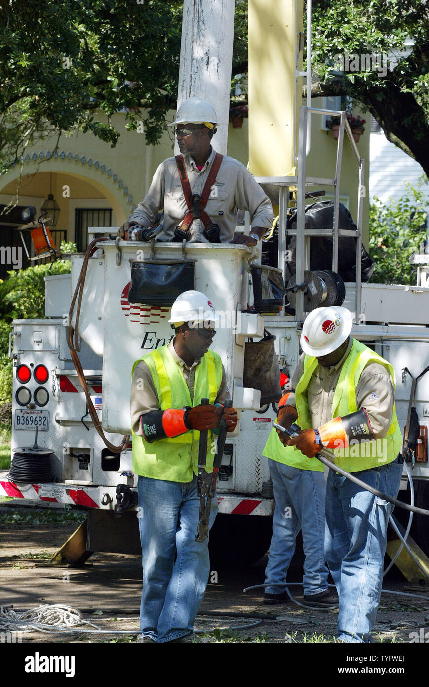 Power crews from Entergy work to restore electrical service
