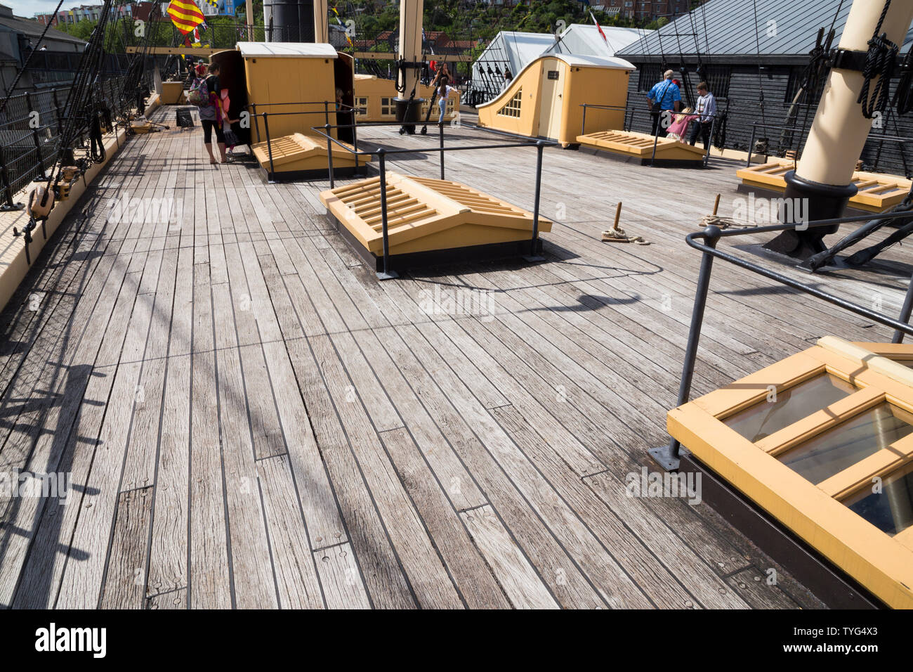 The wooden primary upper deck of the SS Great Britain, Brunel's steam powered ship in dry dock and on a sunny day. The ship is now a museum attraction in Bristol. UK - Stock Image