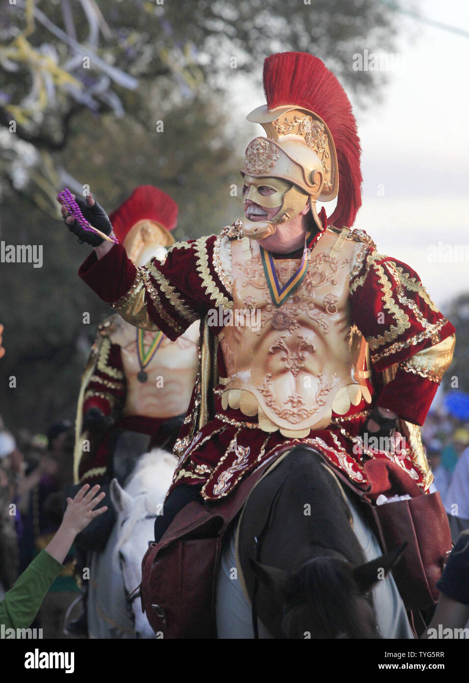 A member of the Krewe of Bacchus Mardi Gras parade toss beads to the crowd from horseback on Napoleon Avenue in New Orleans Sunday, February 26, 2017. The Krewe of Bacchus has been rolling on the traditional Uptown route since 1969.  Photo by AJ Sisco/UPI Stock Photo