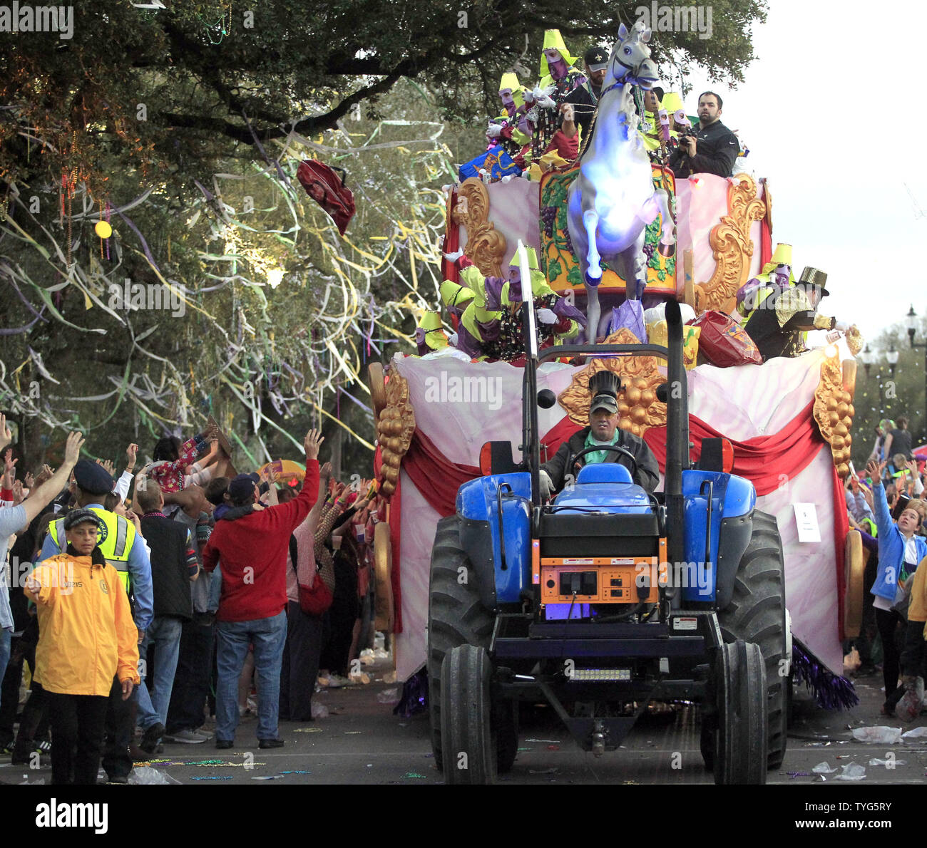 Float riders in the Krewe of Bacchus Mardi Gras parade toss beads to the crowd on Napoleon Avenue in New Orleans Sunday, February 26, 2017. The Krewe of Bacchus has been rolling on the traditional Uptown route since 1969. Photo by AJ Sisco/UPI Stock Photo
