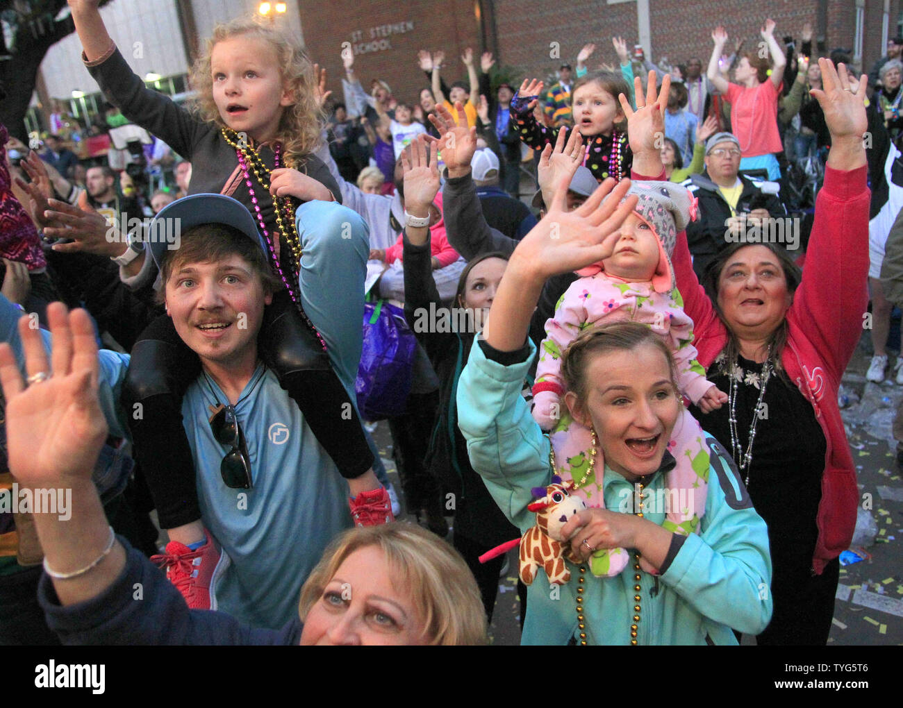 Mardi Gras revelers reach for beads during the Krewe of Bacchus Mardi Gras parade Sunday, February 26, 2017. The Krewe of Bacchus has been rolling on the traditional Uptown route since 1969. Photo by AJ Sisco/UPI Stock Photo