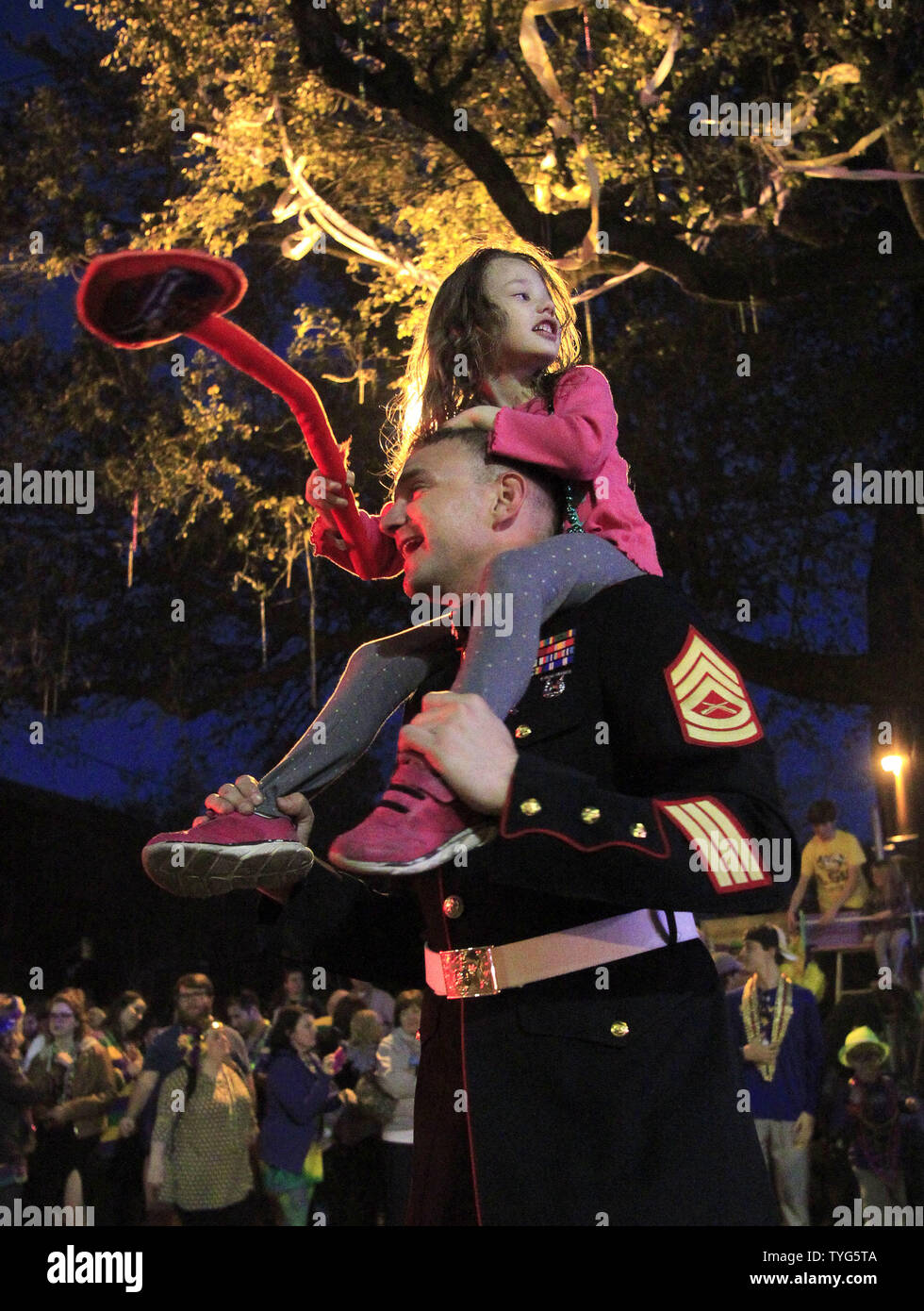 U.S. Marine Corps Gunnery Sgt. Christopher Broadstreet holds Audrey Stewart, 5, daughter of a military buddy, on his shoulders during the Bacchus Mardi Gras parade Sunday, February 26, 2017. The Krewe of Bacchus has been rolling on the traditional Uptown route since 1969. Photo by AJ Sisco/UPI Stock Photo