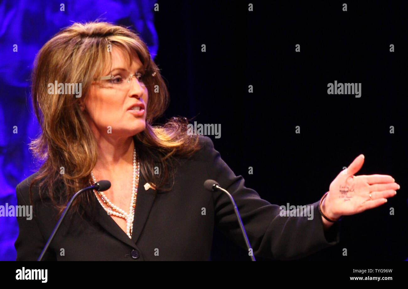 Former Alaska Governor Sarah Palin speaks at the National Tea Party Convention at the Opryland Hotel in Nashville, Tennessee on February 6, 2010. The words 'energy', 'budget cuts', 'tax' and 'lift American spirits' are seen written in ink on her left hand. UPI/Terry Wyatt - Stock Image