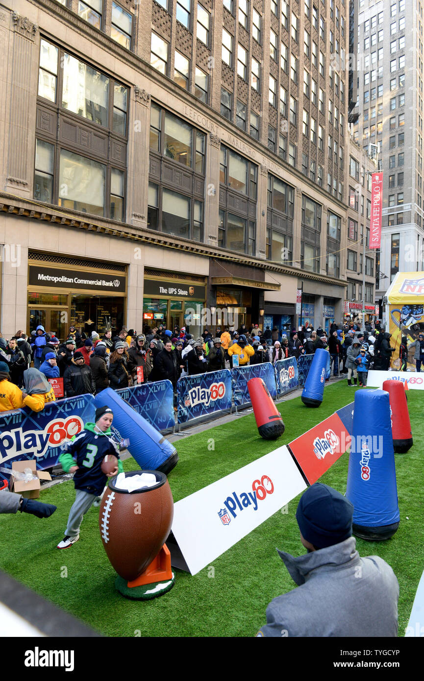 Young fans run an obstacle course near Times Square at the NFL Super Bowl Boulevard Fan Experience that takes up 13 blocks of Broadway in downtown Manhattan, New York on Wednesday, January 30, 2014.  Super Bowl XLVIII fans from the Denver Broncos and Seattle Seahawks fill the streets as they get read for the game on Sunday, February 2, 2014.  UPI/Pat Benic - Stock Image