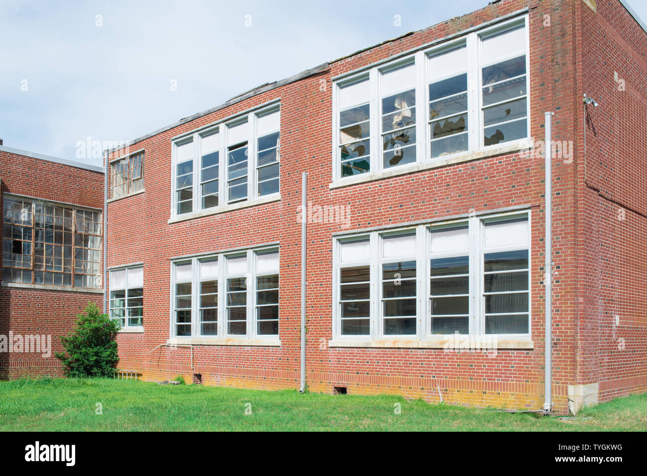 This abandoned historic high school in Painter, Virginia is on the National Register. It has an art deco design. Stock Photo