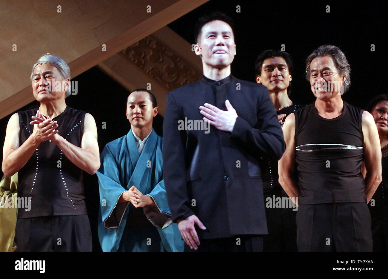 """Cast members Alvin Y.F. Ing, B. D. Wong and Sab Shimono (left to right) take their 12/2/04 opening night curtain call bows in the 2004 Broadway musical revival production of  composer Stephen Sondheim """"Pacific Overtures"""" presented by the Roundabout theatre comapny. (UPI Photo/Ezio Petersen) Stock Photo"""
