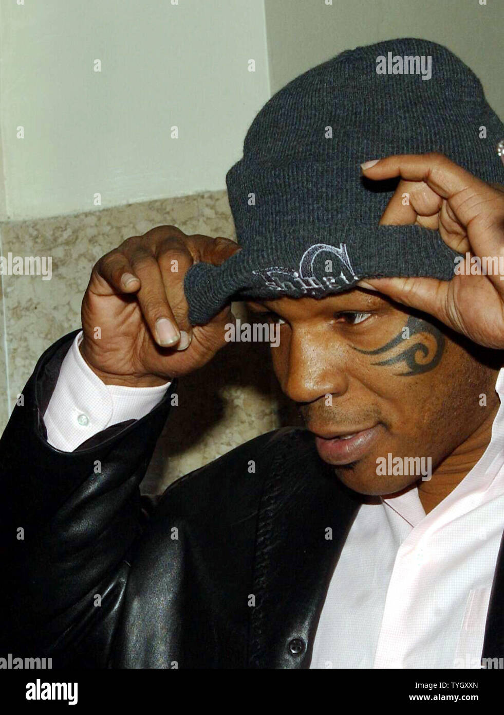 Former Heavyweight boxing champion Mike Tyson arrives at Brooklyn Criminal Court on 12/15/04 to complete his sentencing on assualt charges.The case was closed with Tyson having completed community service work.  (UPI Photo/Ezio Petersen) Stock Photo