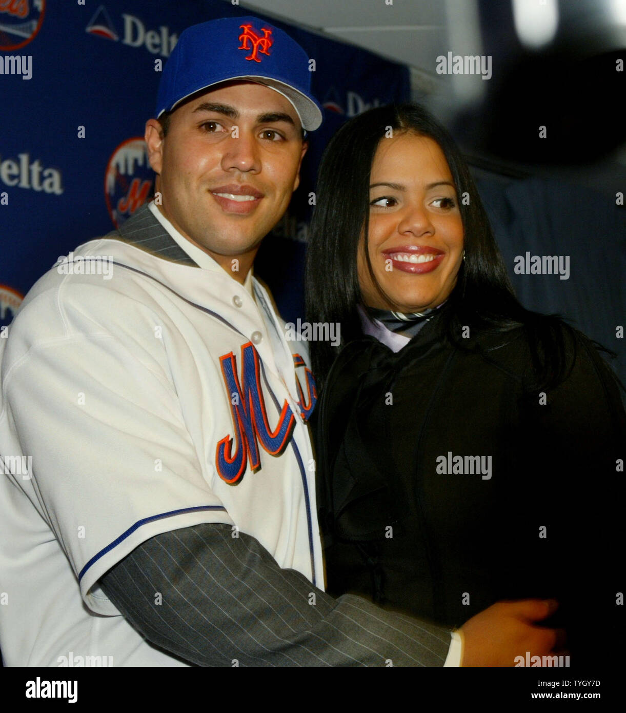 Carlos Beltran Is Joined By His Wife Jessica During A Press