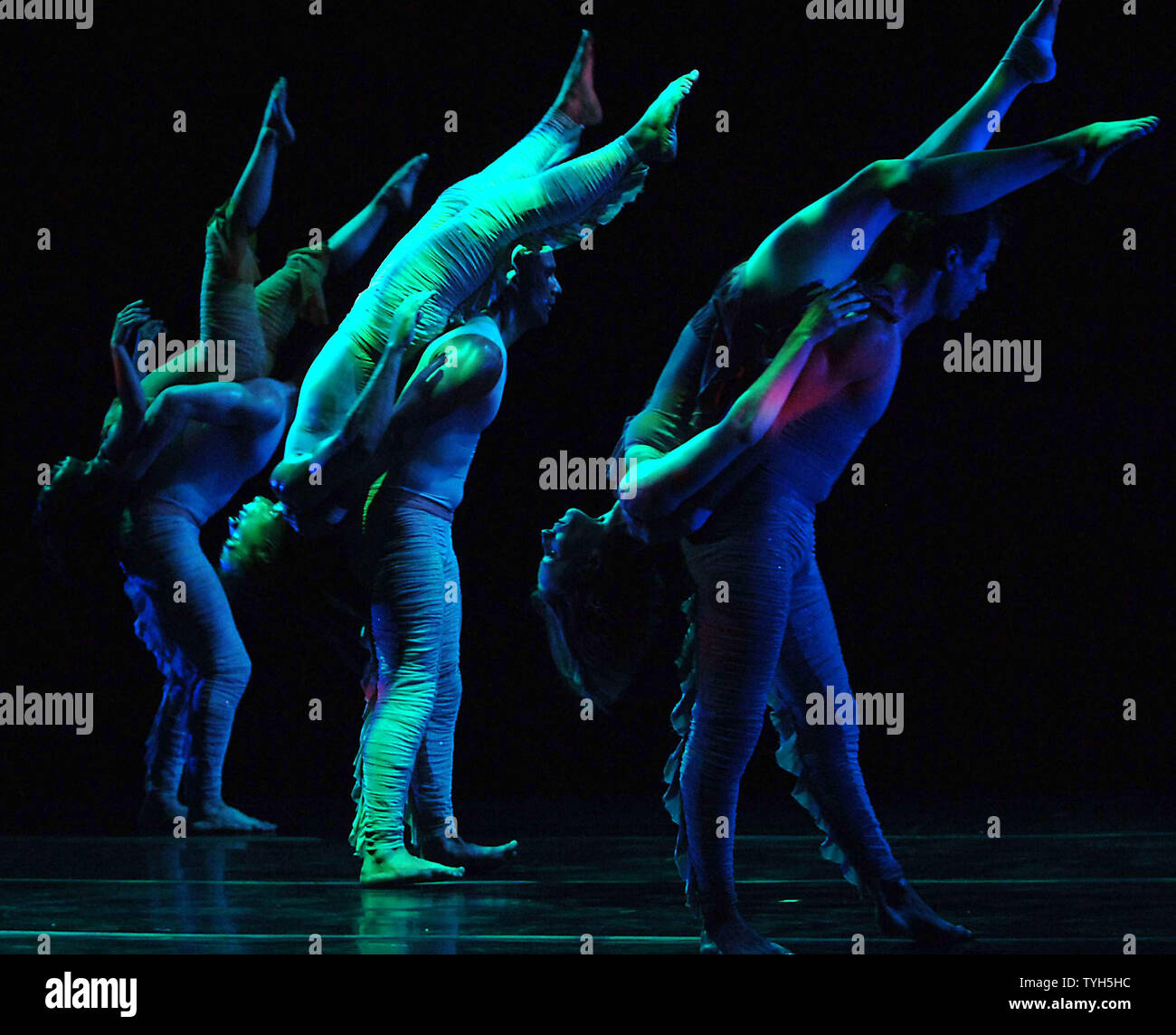 """Members of the Pilobolus dance company rehearse their new ballet """"Aquatica (2005) """" which will debut on July 11, 2005 at New York's Joyce theatre.  (UPI Photo/Ezio Petersen) Stock Photo"""