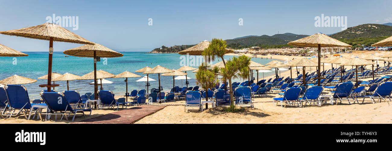 Ammolofoi beach is one of the best beaches in Northern Greece with golden sand and crystal clear water. Panoramic view from one of the many beach bars - Stock Image