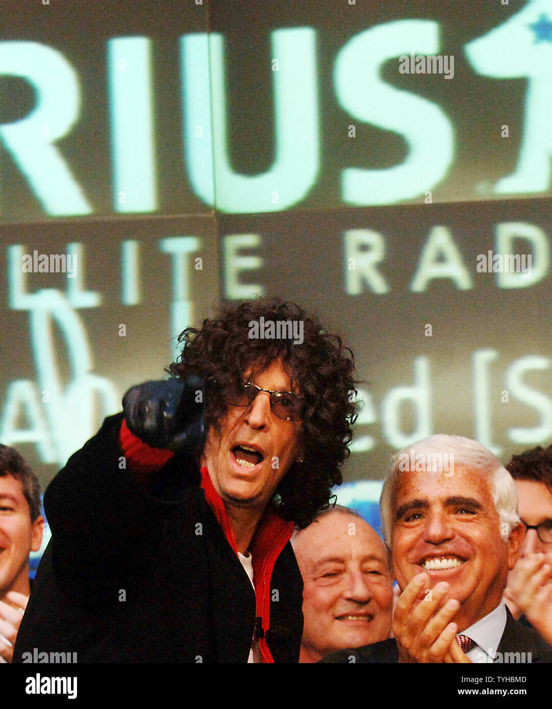 Radio talk show host Howard Stern (left) points out something of