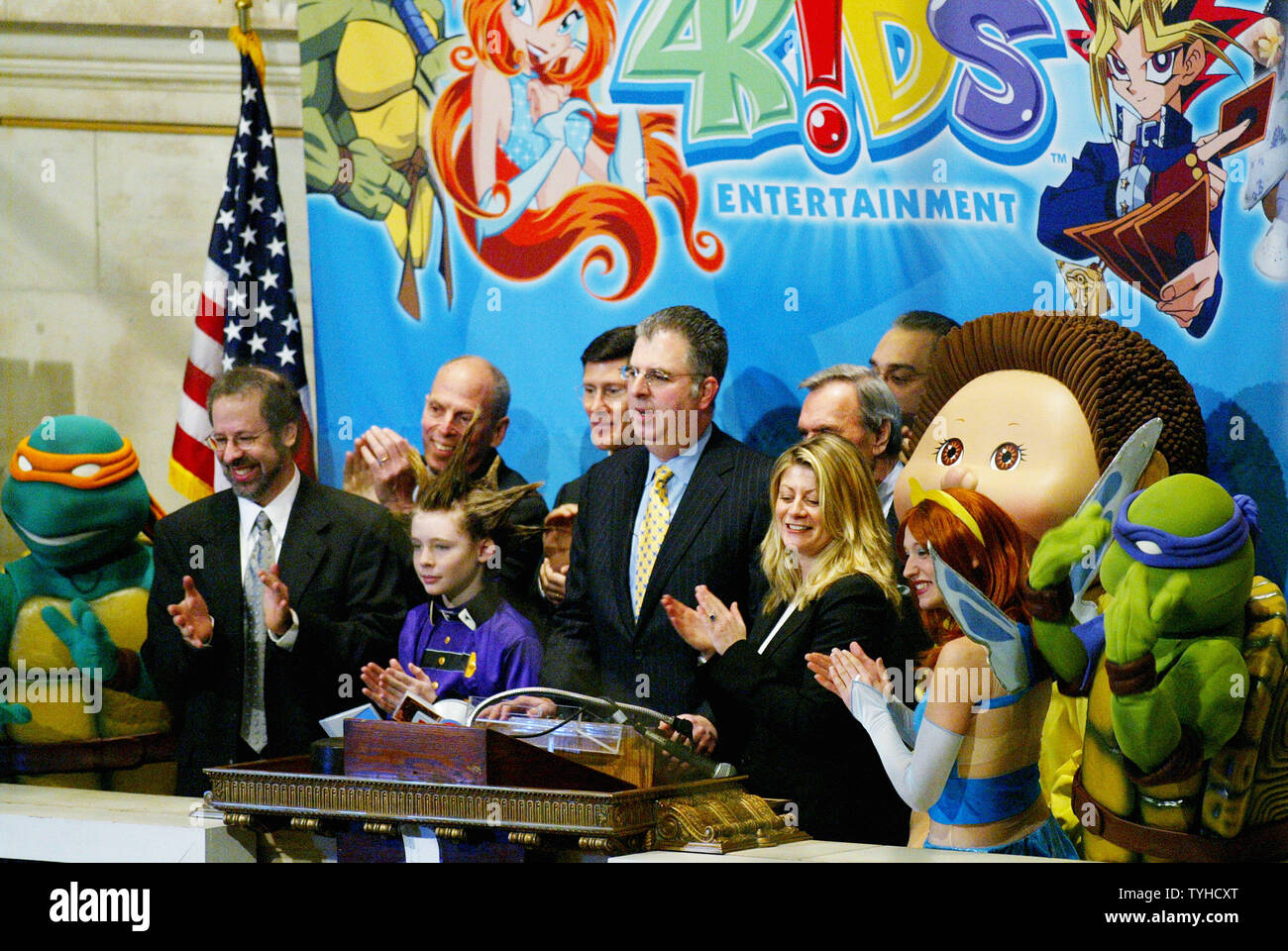 Alfred Kahn, center, chairman and CEO of 4 Kids Entertainment, is
