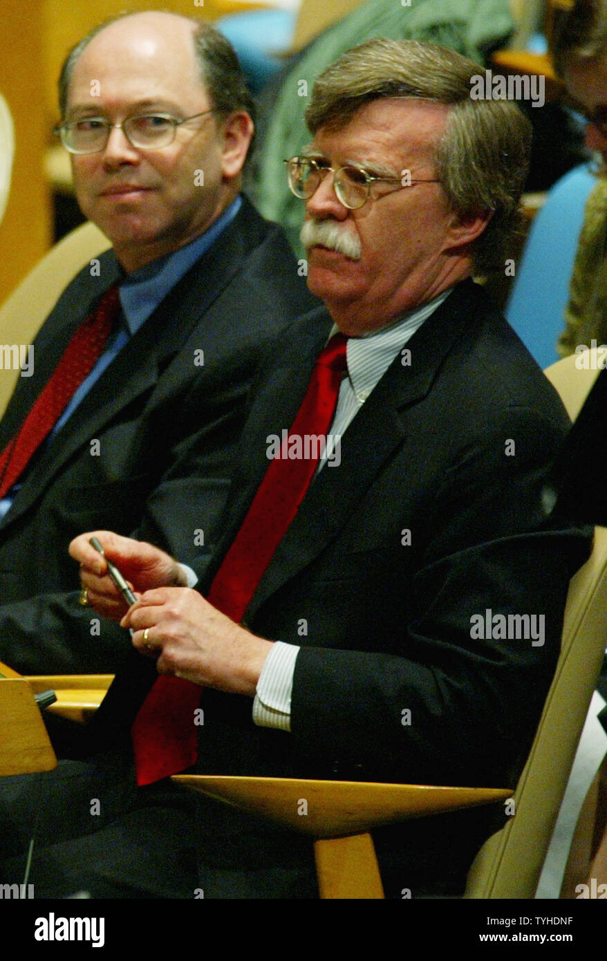 United State's ambassador to the United Nations John Bolton, left, discusses his vote against the creation of a new United Nations Human Rights Council during the General Assembly meeting at the UN on March 15, 2006 in New York City. The resolution passed by 170 to 4 votes. (UPI Photo/Monika Graff) - Stock Image