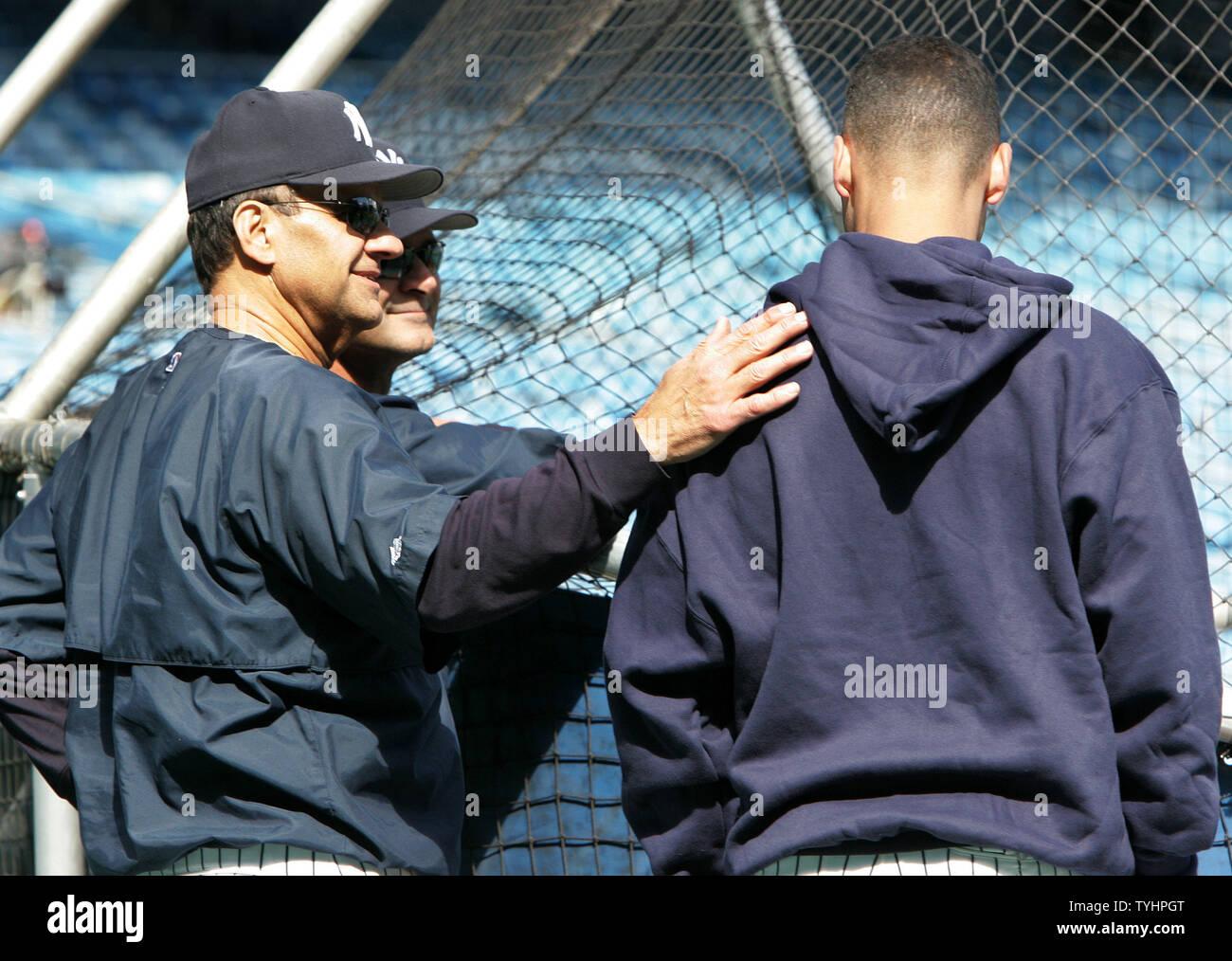 New York Yankees' manager Joe Torre, left, gives shortstop Derek