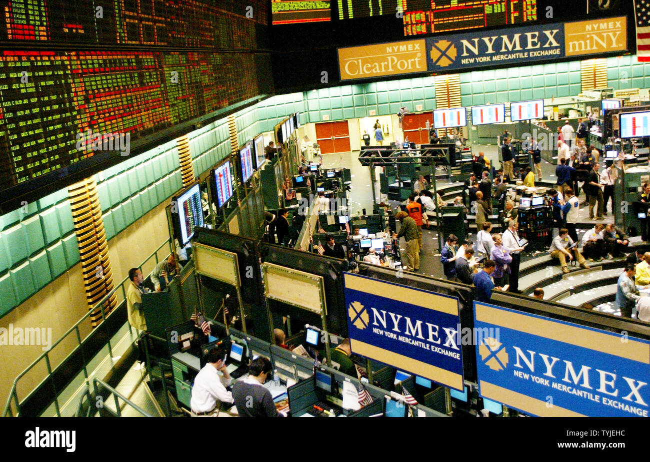 Traders conduct business on the floor of the NYMEX after light