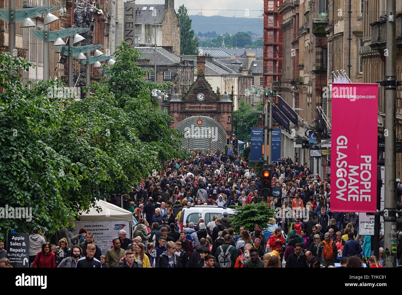 Glasgow, Scotland - June 8, 2019: The famous shopping district in the city, Buchanan Street, is shown filled with people during an afternoon day. Stock Photo