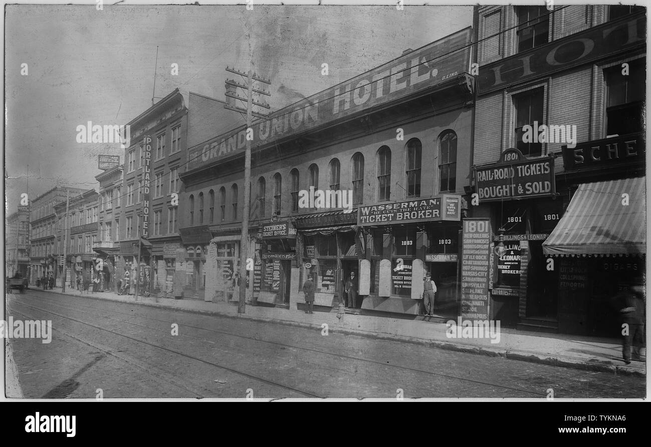Street scenes showing railroad ticket broker offices on Market Street in St. Louis.; Scope and content:  Other businesses shown include the Grand Union Hotel, Portland Hotel, Boulevard Hotel, and a drug store. Some photographs include pedestrians and shopkeepers. No. 15 is an exchange order from broker S. Steiner. Stock Photo