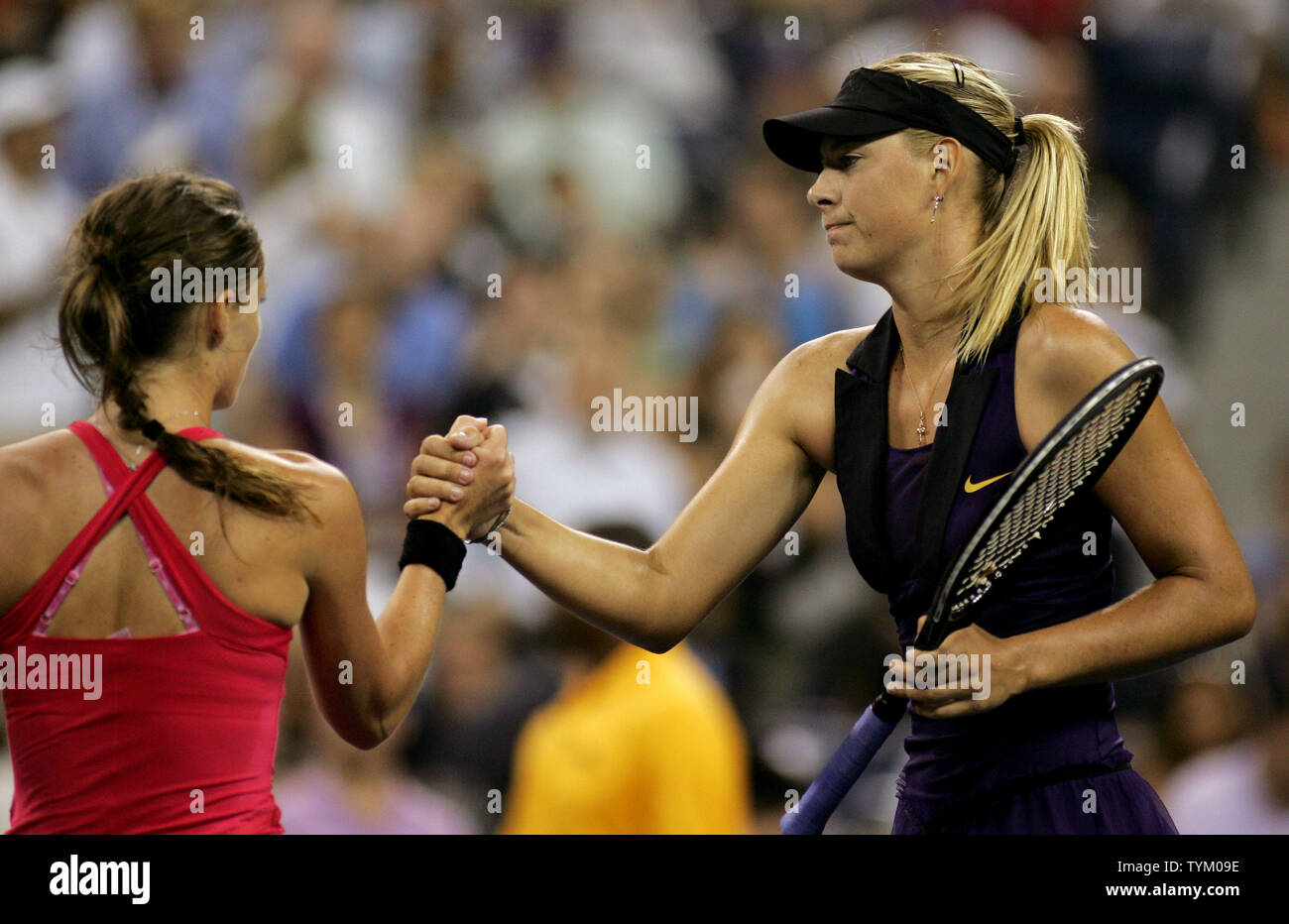 Iveta Benesova (L) of the Czech Republic and Maria Sharapova of Russia shake hands at the conclusion of their match where Sharapova won during second-round action at the U.S. Open held at the National Tennis Center on September 2, 2010 in New York.     UPI Photo/Monika Graff... - Stock Image