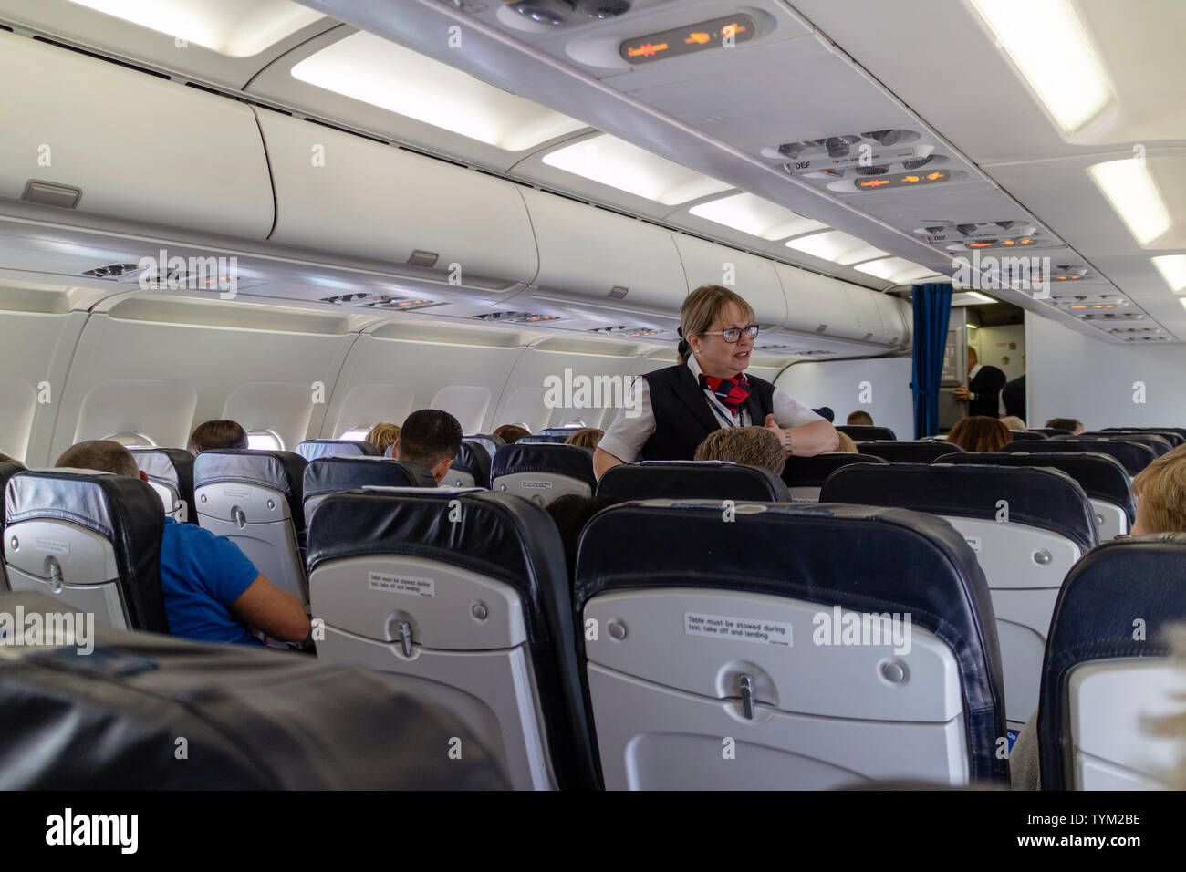 British Airways Cabin Crew Uniform Stock Photos & British