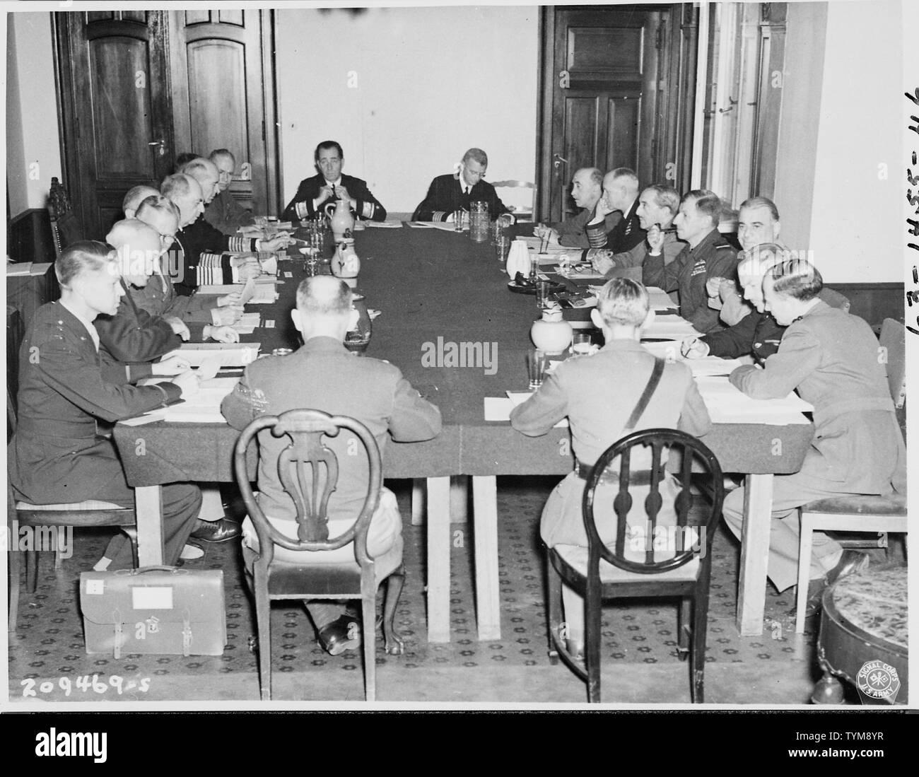 The Combined Chiefs of Staff meet on the 4th day of the Potsdam Conference in Germany. Clockwise, L to R: Maj. Gen. Lauris Norstad, Gen. Henry H. Arnold, Gen. George C. Marshall, Brig. Gen. Andrew J. McFarland, Adm. William D. Leahy, Adm. Ernest J. King, Vice-Adm. C. M. Cooke, Jr., Gen. Brehon B. Somervell, Rear Adm. H. A. Flanigan, Captain C. J. Moore, Lt. Gen. Sir Gordon McCready, Adm. Sir Andrew Cunningham, Field Marshall Sir Alan Brooke, Marshall Sir Charles Portal, Gen. Sir Hastings Ismay, Gen. L. C. Hollisd, Brig. A. T. Cornwall-Jones, Col. Thomas Haddon, and Lt. Gen. John E. Hull. - Stock Image