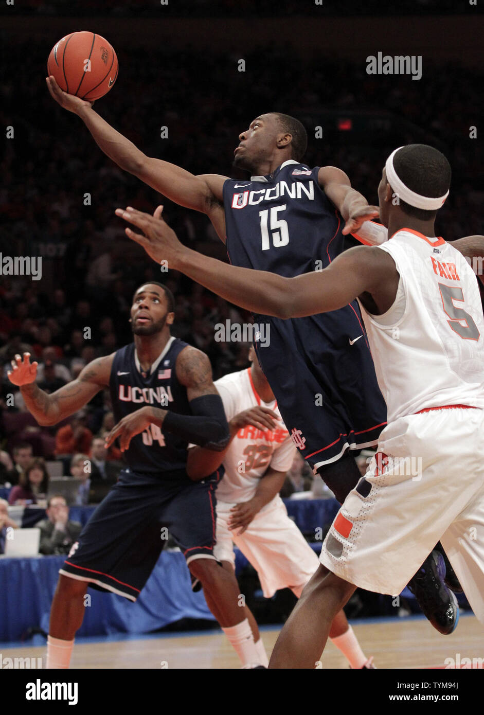 Connecticut Huskies Kemba Walker Drives To The Basket In The