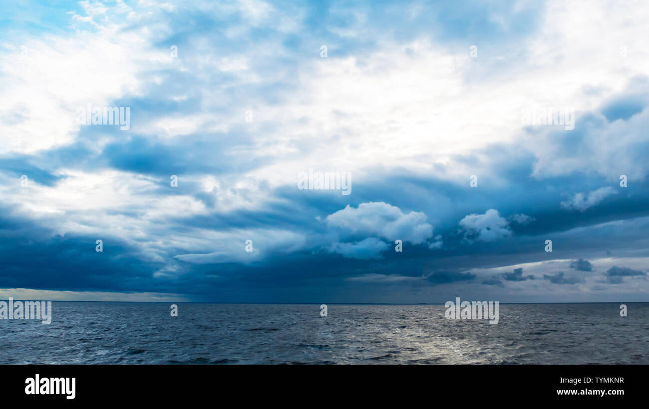 River and cloudy sky - Stock Image