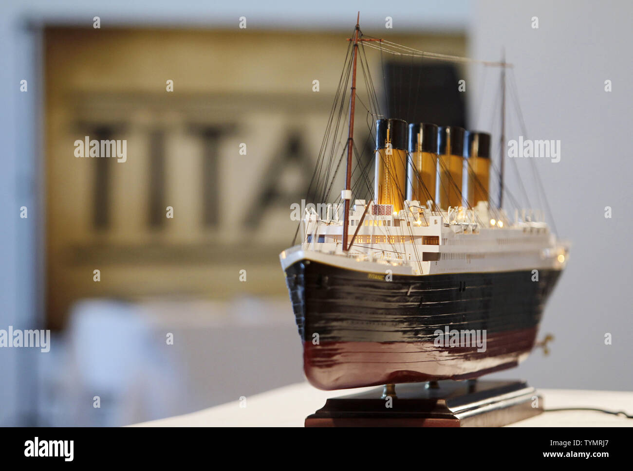 A model of the RMS Titanic sits on a table near where Artifacts recovered from the wreck site of the on display before being auctioned at the Intrepid Sea, Air & Space Museum in New York City on January 5, 2012. The auction will take place on April 11, 2012 on the 100 year anniversary of the ships maiden voyage and will be sold as one single collection.    UPI/John Angelillo - Stock Image