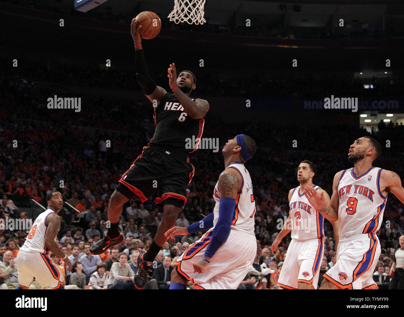 0eb2ac315c44 New York Knicks Carmelo Anthony watches Miami Heat Lebron James drive to  the basket in the