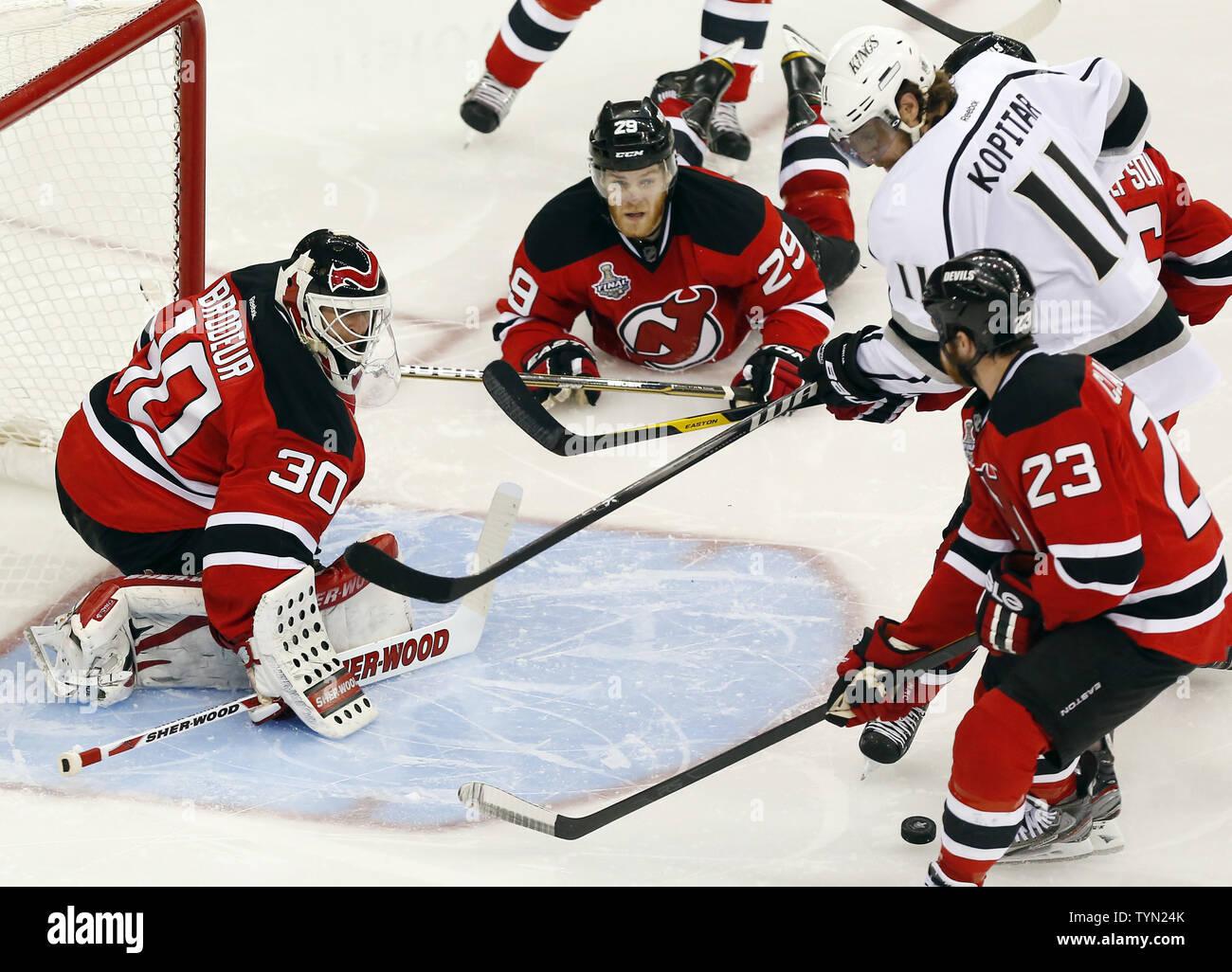 New Jersey Devils goalie Martin Brodeur stops a shot from