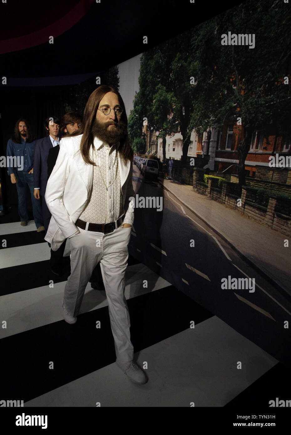Wax figures John Lennon, Ringo Star, Paul McCartney and George Harrison of The Beatles are posed to recreate the Abbey Road album cover on McCartney's 70th Birthday at Madame Tussauds in New York City on June 14, 2012.       UPI/John Angelillo - Stock Image