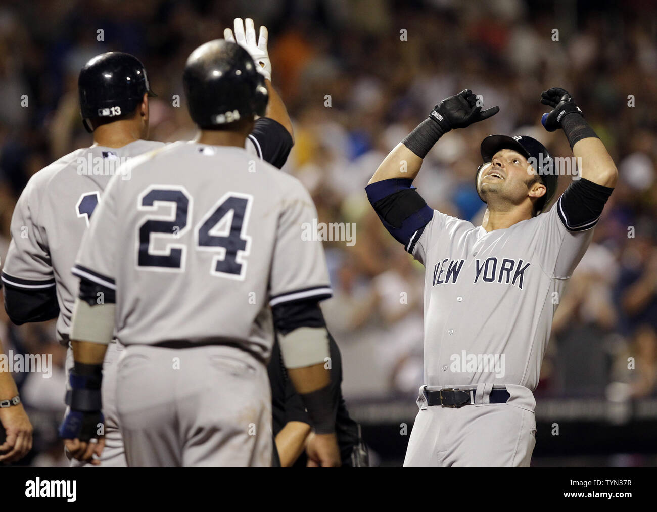 official photos 3327c 3811c New York Yankees Nick Swisher reacts at home plate with Alex ...