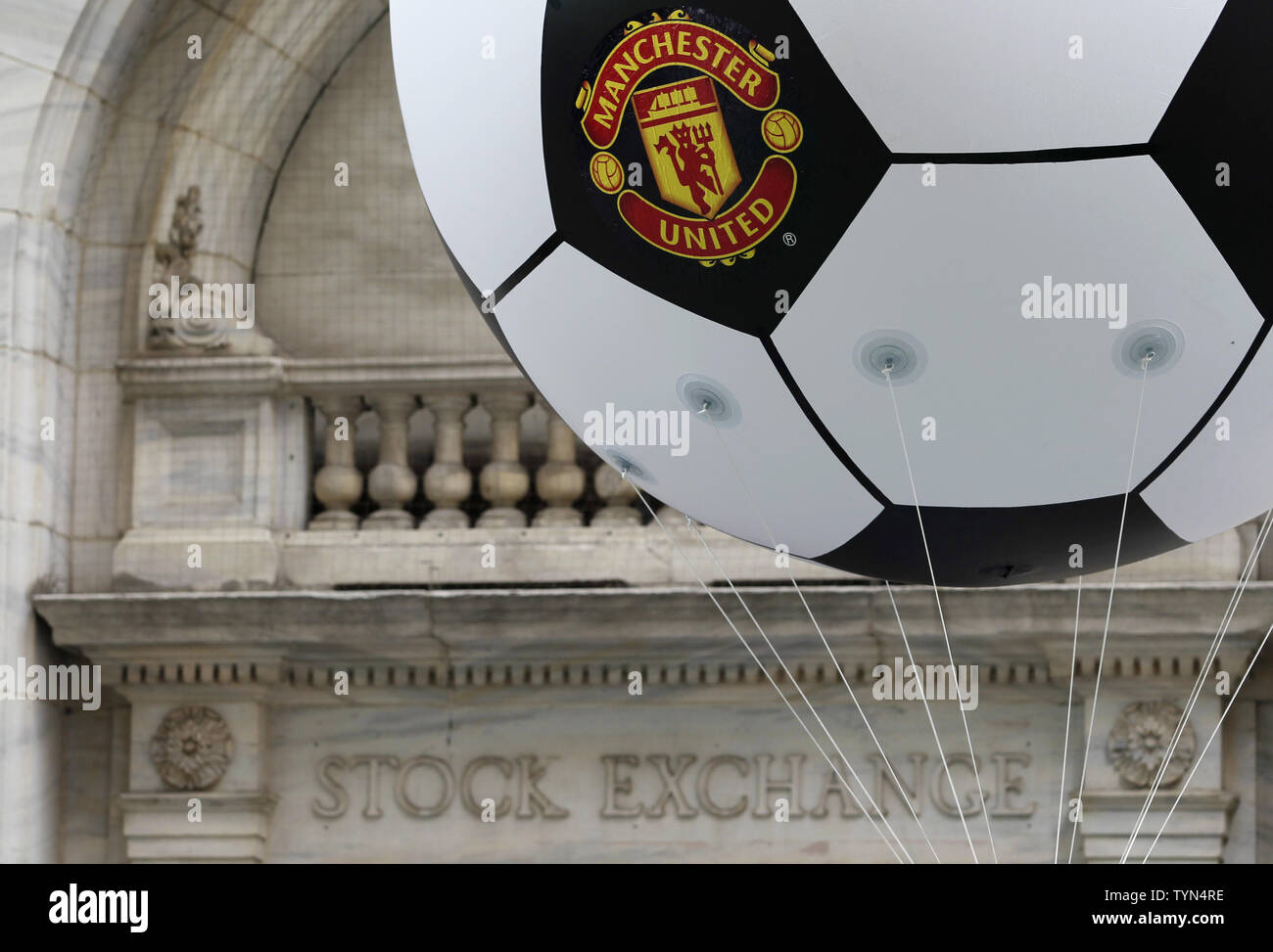 A Soccer Ball With The Manchester United Logo Floats Outside Of The New York Stock Exchange