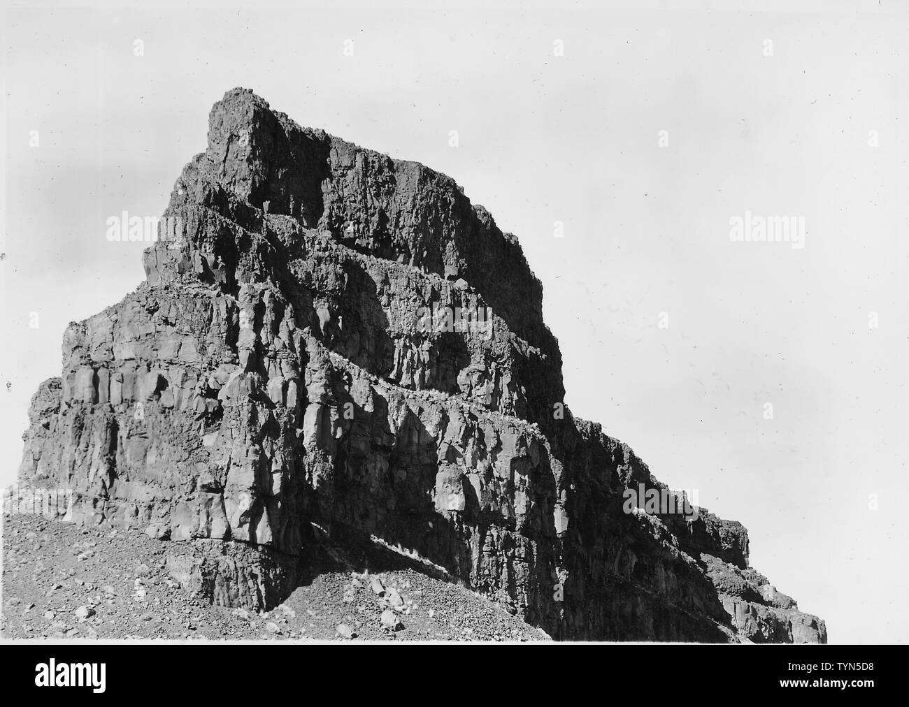 Typical rim-rock formation in Grand Coulee. Some 20 distinct lava flows are traceable in the cliffs of basalt which mark the gorge.; Scope and content:  Photograph from Volume Two of a series of photo albums documenting the construction of the Grand Coulee Dam and related work on the Columbia Basin Project. Stock Photo