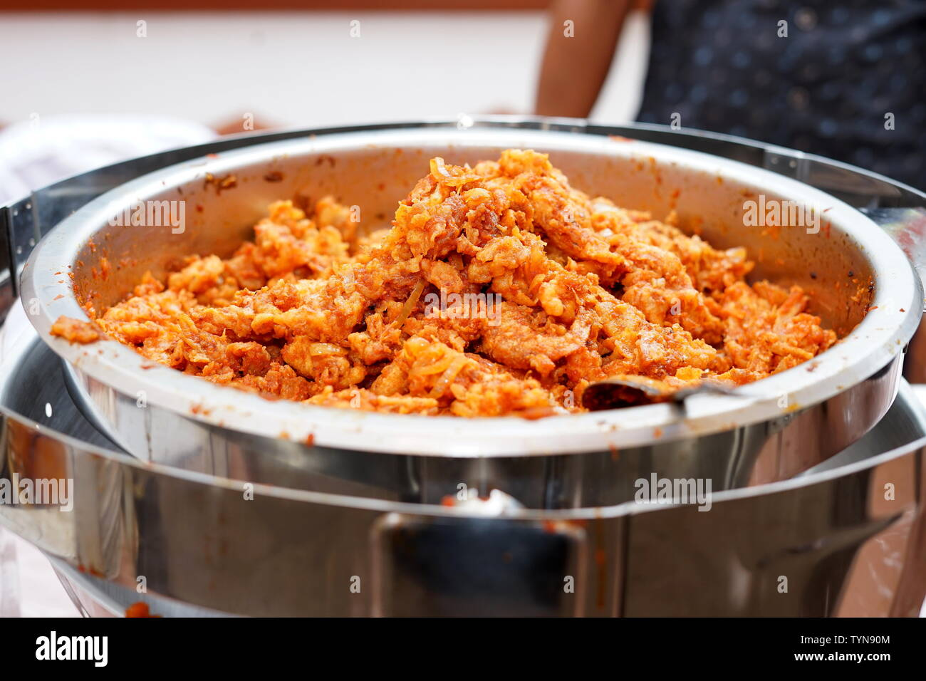 Fried breaded shrimp with Spicy sauces on the buffet - Stock Image