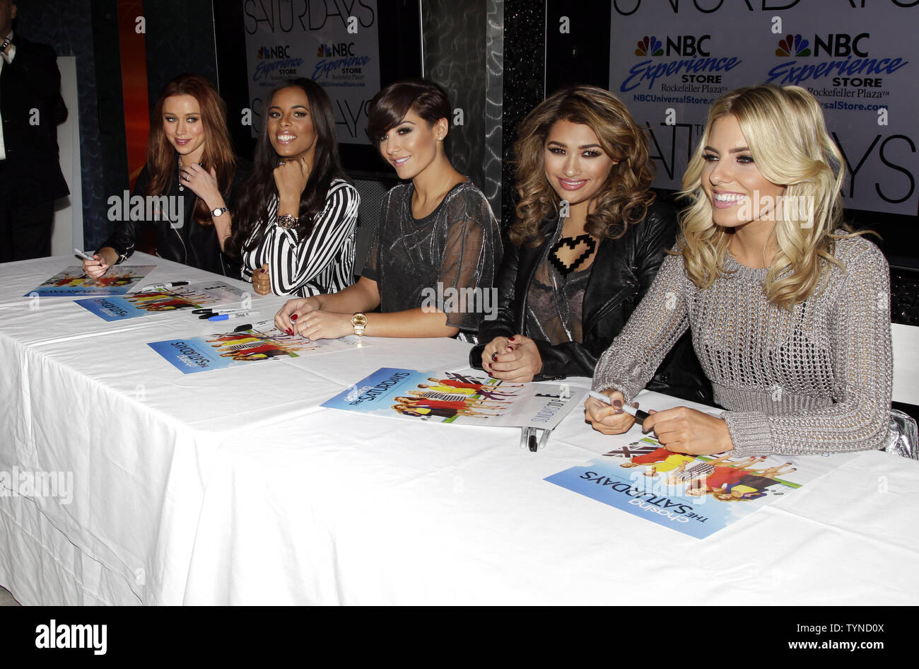 Mollie King, Vanessa White, Frankie Sandford, Rochelle Humes and Una Healy (R) of The Saturdays promote 'Chasing The Saturdays' at the NBC Experience Store in New York City on January 17, 2013.       UPI/John Angelillo - Stock Image