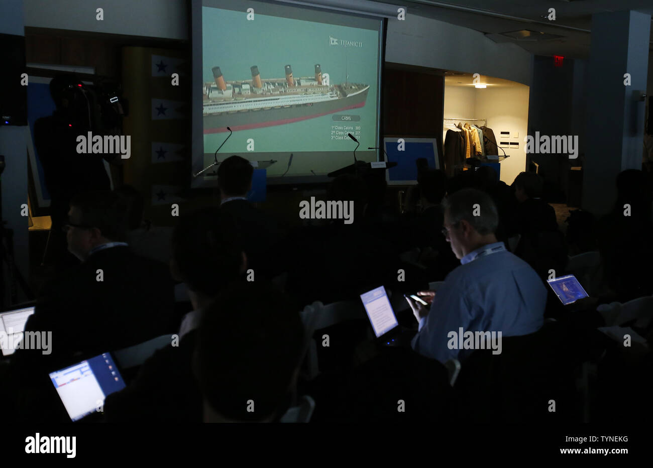 Members of the media watch a video before Australian billionaire and chairman of the shipping company Blue Star Line, Clive Palmer, discusses plans for the company's planned Titanic II cruise ship at the Intrepid Sea, Air & Space Museum in New York City on February 26 2013. The ship was designed by marine engineering company Deltamarin Ltd. of Raisio, Finland, and is scheduled to be completed by 2016 by the CSC Jinling Shipyard Co. in China.    UPI/John Angelillo - Stock Image
