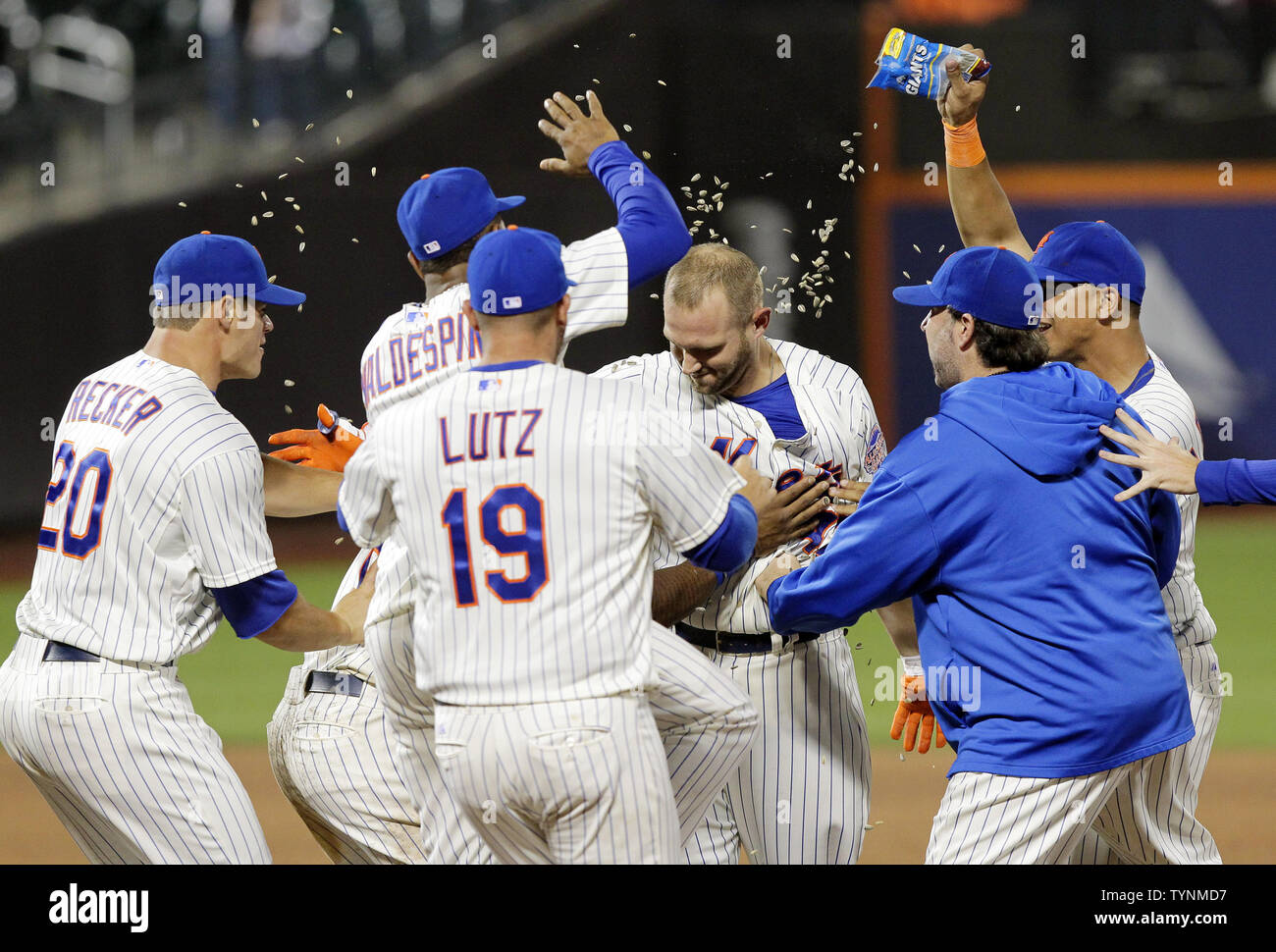 quality design 9d9b0 e8a53 The New York Mets team join Andrew Brown on the field after ...