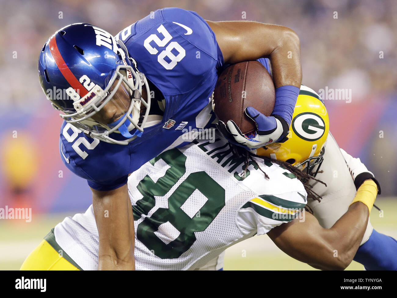 new product 5320b a0052 Green Bay Packers Tramon Williams tackles New York Giants ...