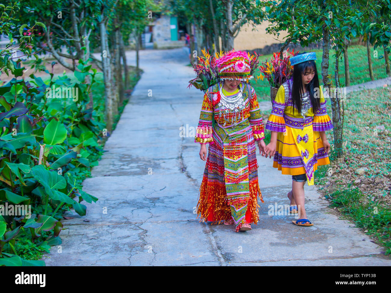 Girls from the Hmong minority in a village near Dong Van in Vietnam - Stock Image