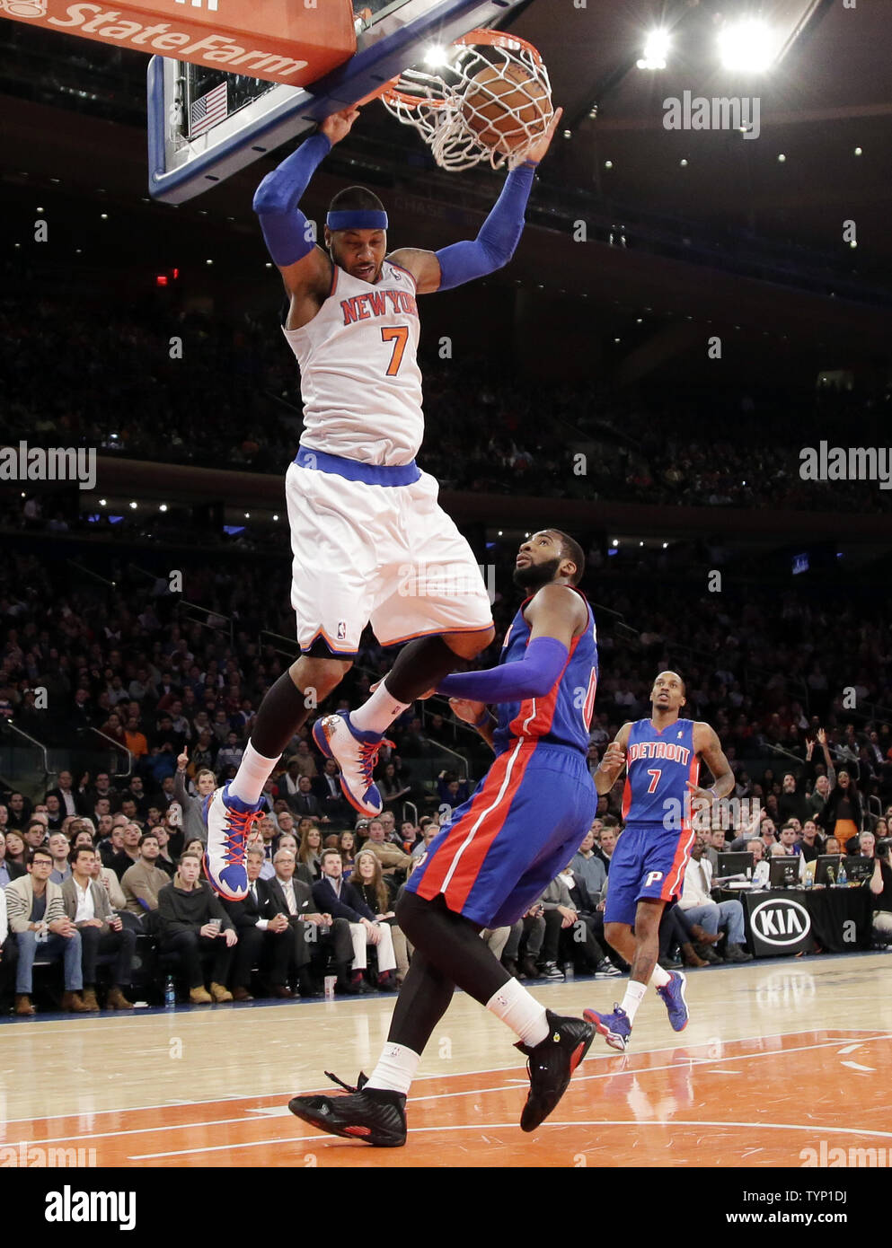 New York Knicks Carmelo Anthony dunks the basketball over Detroit Pistons Andre Drummond in the third quarter at Madison Square Garden in New York City on January 7, 2014. The Knicks defeated the  Pistons  89-85.     UPI/John Angelillo Stock Photo