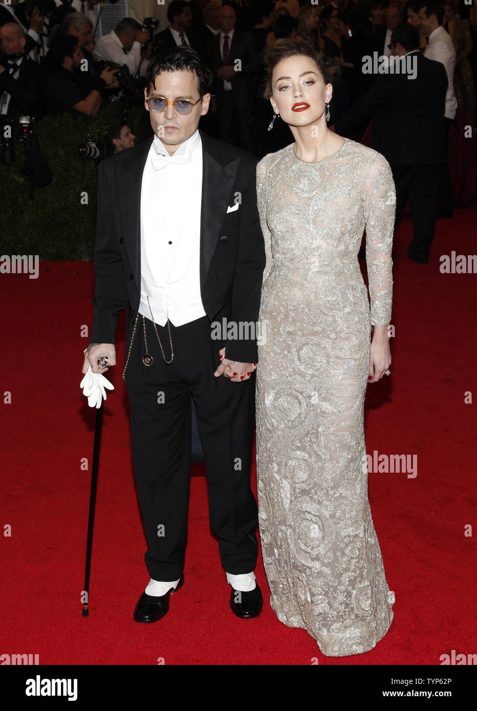 Johnny Depp and Amber Heard arrive on the red carpet at the Costume Institute Benefit celebrating the opening of Charles James: Beyond Fashion and the new Anna Wintour Costume Center at the Metropolitan Museum of Art in New York City on May 5, 2014.    UPI/John Angelillo - Stock Image
