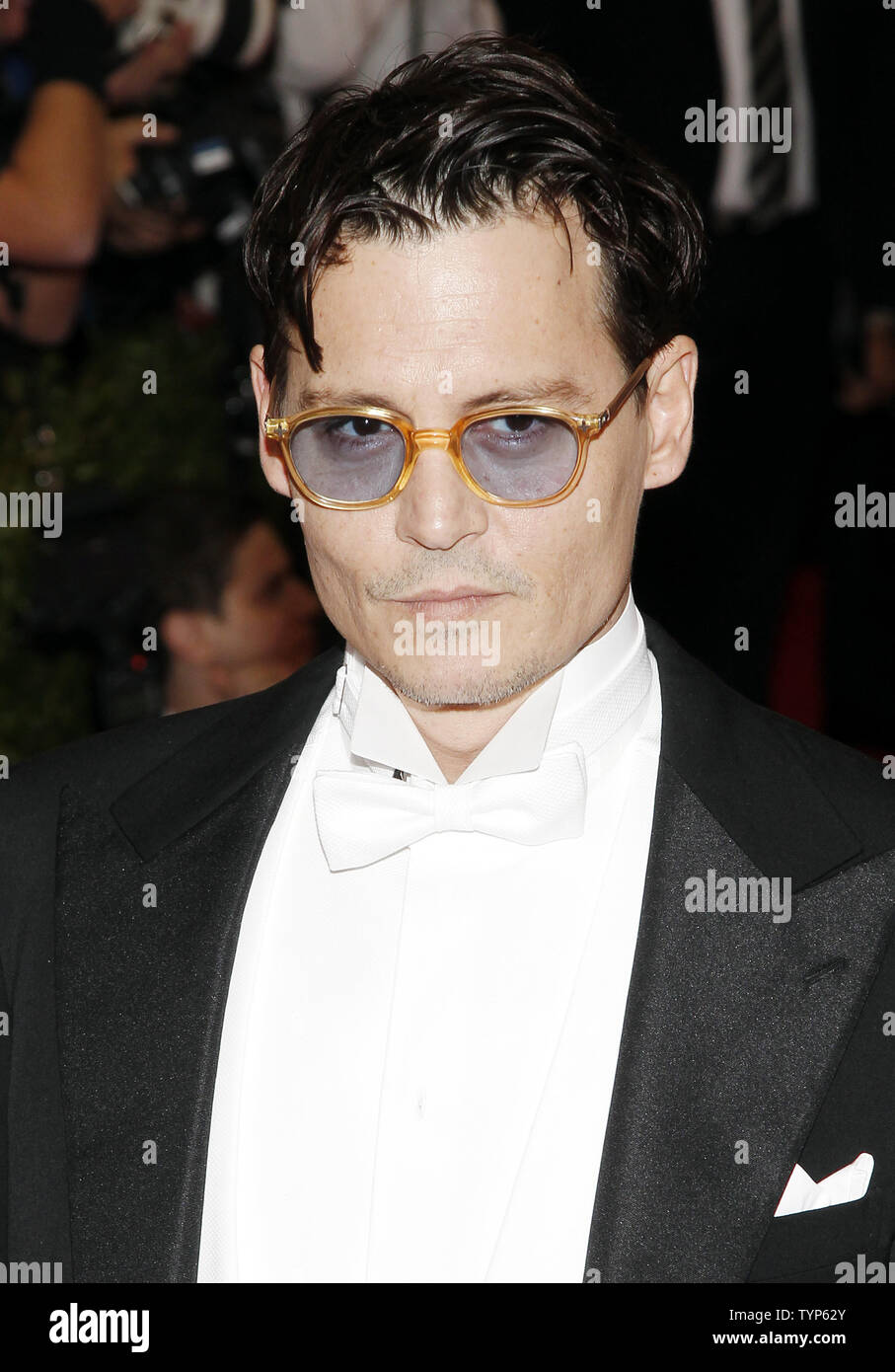 Johnny Depp arrives on the red carpet at the Costume Institute Benefit celebrating the opening of Charles James: Beyond Fashion and the new Anna Wintour Costume Center at the Metropolitan Museum of Art in New York City on May 5, 2014.    UPI/John Angelillo - Stock Image