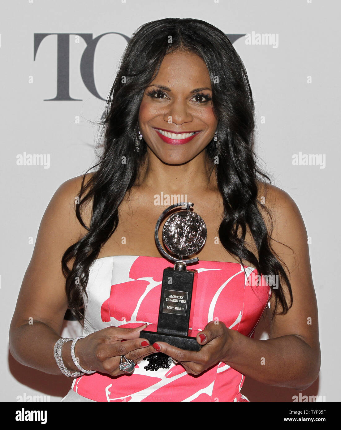 Audra McDonald of ÒLady Day at EmersonÕs Bar & GrillÓ with her Tony Award for Best Performance by a Leading Actress in a Play in the press room during 68th Tony Awards at Radio City Music Hall in New York City on June 8, 2014. The annual awards, which are presented by the American Theatre Wing, recognizes the achievements of Broadway theater.     UPI/John Angelillo. - Stock Image