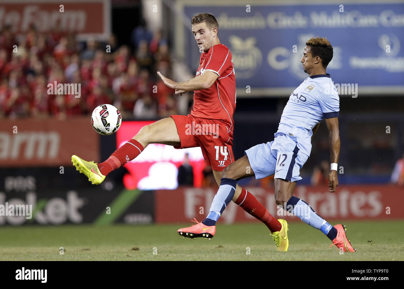 Manchester City Scott Sinclair defends Liverpool FC Jordan Henderson who brings the ball across the field at the Guinness International Champions Cup at Yankee Stadium in New York City on July 30, 2014. The Guinness International Champions Cup is a unique tournament featuring eight of the world's best and most recognizable soccer clubs including Real Madrid CF, Manchester United, Manchester City, Liverpool FC, AS Roma, Inter Milan, AC Milan and Olympiacos. The Final score was Manchester City 2 Liverpool 2 and Liverpool won 3-1 on penalties.     UPI/John Angelillo - Stock Image