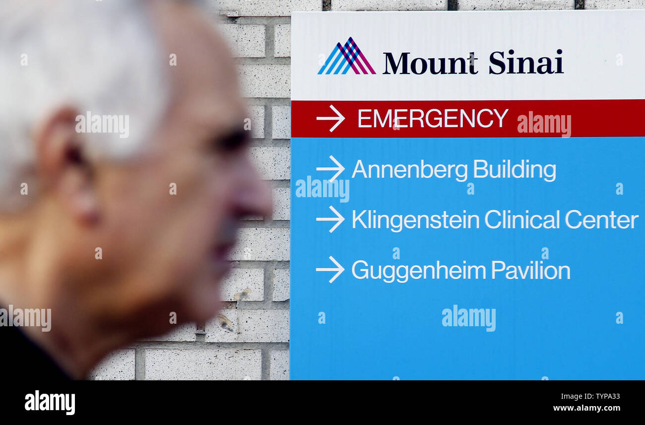 People walk by Mount Sinai Hospital in New York City on