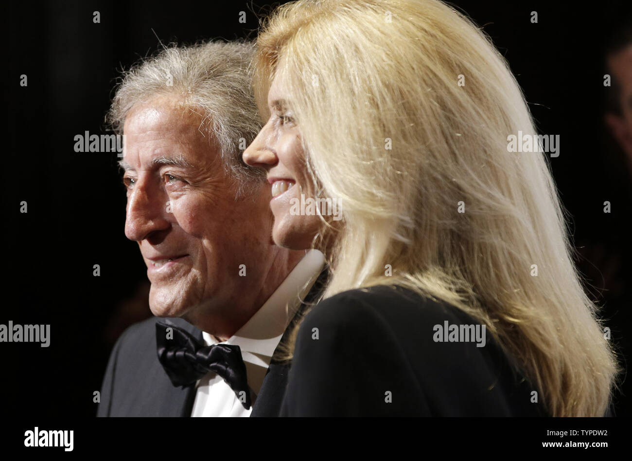Tony Bennett and Susan Crow arrive on the red carpet at the Friars Foundation Gala honoring Robert De Niro and Carlos Slim at The Waldorf Astoria in New York City on October 7, 2014.      UPI/John Angelillo - Stock Image