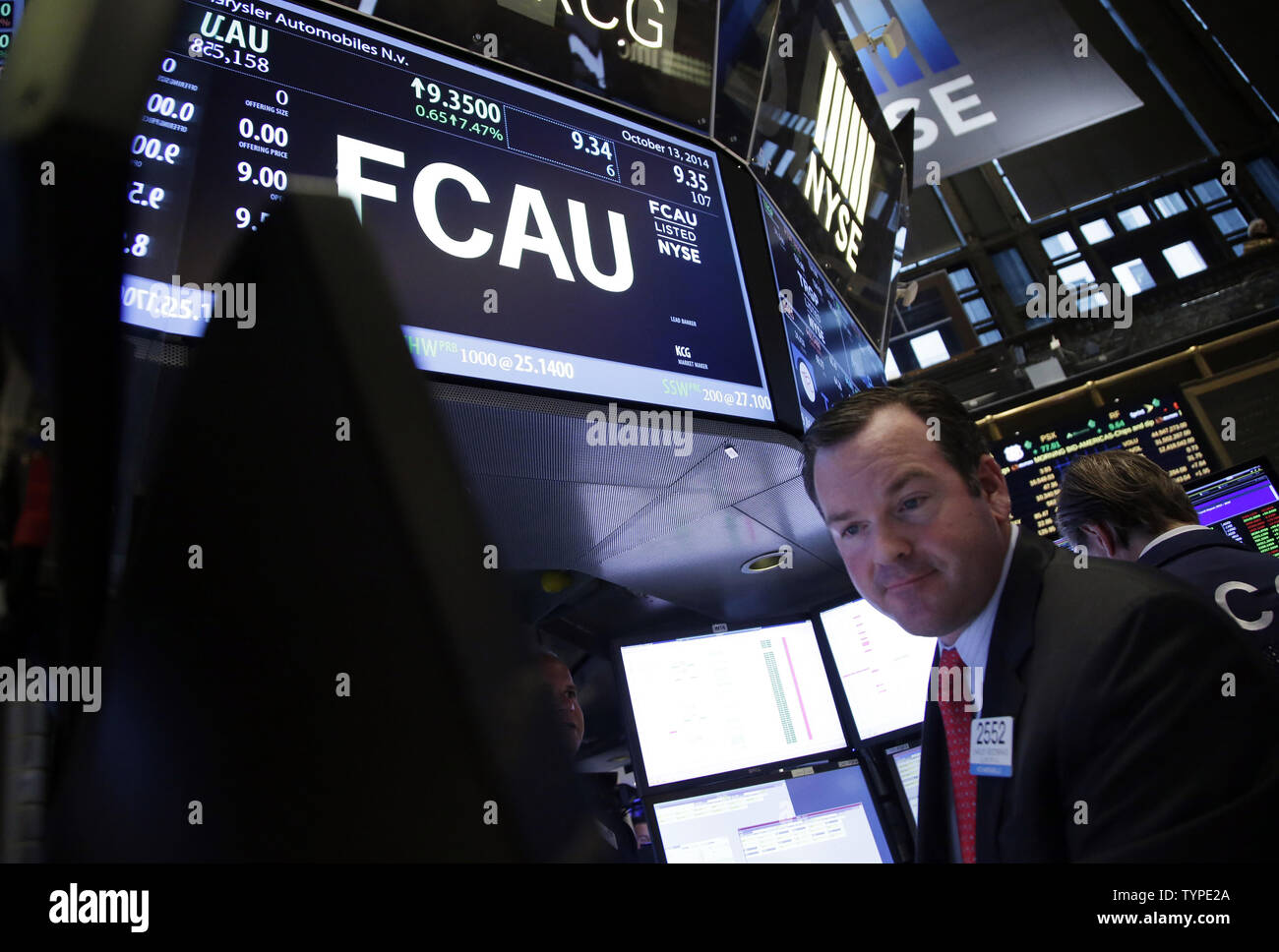 Traders work after Fiat Chrysler Automobiles begins trading for the first time on the New York Stock Exchange at the opening bell on Wall Street in New York City on October 13, 2014. Fiat Chrysler Automobiles began trading on the New York Stock Exchange on Monday under the symbol FCAU.     UPI/John Angelillo Stock Photo